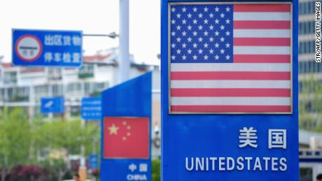Trump fights China on trade, surrenders on human rights