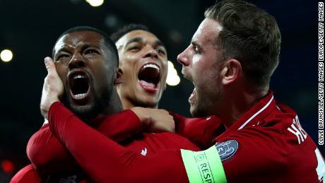 Wijnaldum celebrates after scoring Liverpool's third goal.