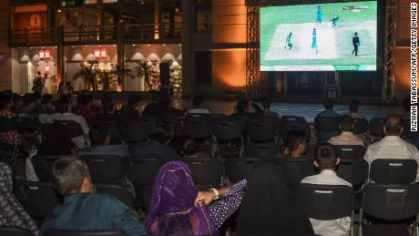 Cricket fans in Karachi come together in a local venue to watch the Asia Cup encounter with India.