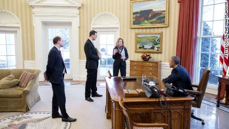 President Obama is briefed by George Selim, second from left, ahead of a White House Summit on Countering Violent Extremism.
