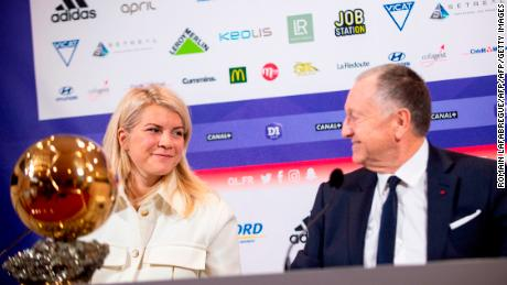 Hegerberg (L) with Lyon's French President Jean-Michel Aulas.