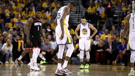 Durant walks off the court after straining his right calf in the game against the Houston Rockets.
