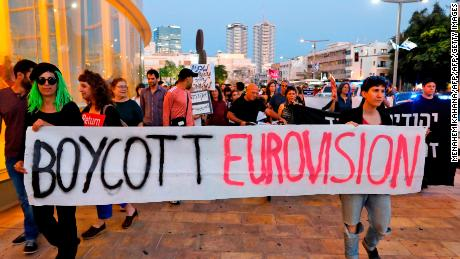 Israelis hold slogans during a protest against Eurovision on May 14 in Tel Aviv.