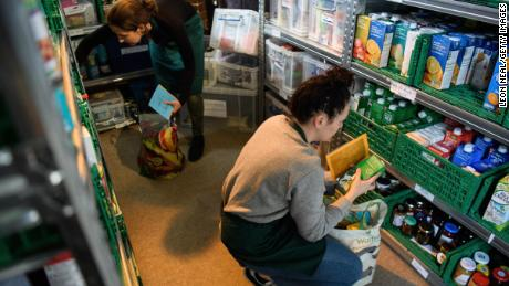 A file photograph of volunteers at London foodbank preparing food parcels in 2017.