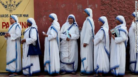 Nuns wait in queue to cast their vote at a polling station during the last phase of Lok Sabha Election or general election on May 19, 2019.
