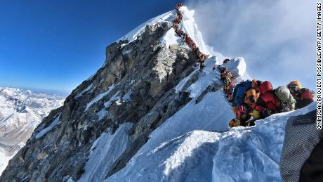 Climbers wait to reach the summit of Everest in this image taken May 22.