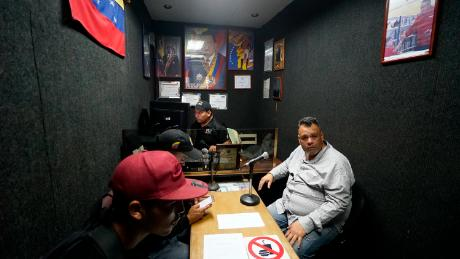 The Venezuelan radio host leading an armed 'colectivo' in support of Maduro