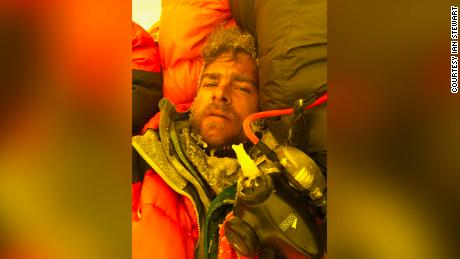 Ian Stewart covered in icicles and snow collapses in his tent after summiting Everest.