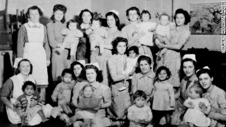 GI babies who grew up in care, like these at Holnicote House, seen here with the nurses who cared for them, were regularly photographed in an attempt to find adoptive families.