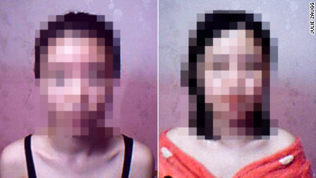 The blurred faces of the two women who escaped from cybersex slavery.
