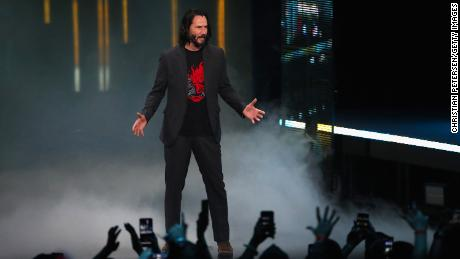 """LOS ANGELES, CALIFORNIA - JUNE 09:  Actor Keanu Reeves speaks about """"Cyberpunk 2077"""" from developer CD Projekt Red during the Xbox E3 2019 Briefing at The Microsoft Theater on June 09, 2019 in Los Angeles, California. (Photo by Christian Petersen/Getty Images)"""