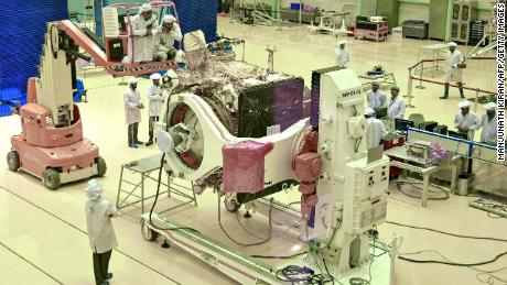 Indian Space Research Organisation (ISRO) scientists work on the orbiter vehicle of 'Chandrayaan-2' in Bangalore.