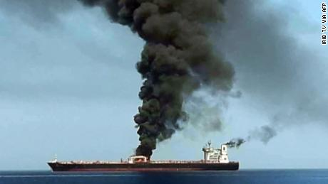 This still, obtained by AFP from Iranian State TV IRIB, purports to show smoke billowing from a tanker said to have been attacked off the coast of Oman, at an undisclosed location. CNN has not independently verified this image.