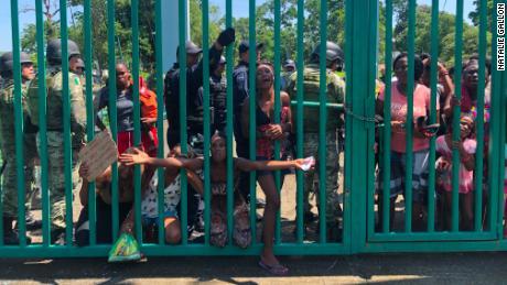 Migrants at detention center Feria Internacional Mesoamericana in Tapachula.
