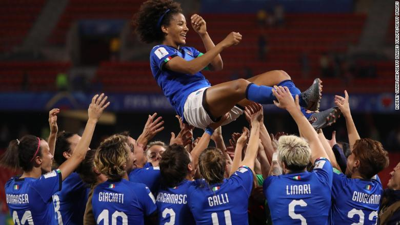 Sara Gama of Italy is thrown in the air by her teammates.
