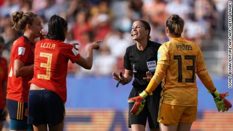 Referee Katalin Kulcsar argues with Spain's defender Leila Ouahabi (2ndL) and Spain's goalkeeper Sandra Panos (R) after giving a penalty kick.