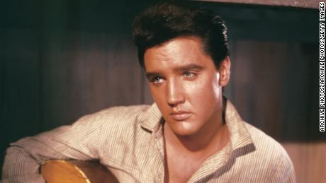 Who can resist this portrait of Elvis Presley holding an acoustic guitar, circa 1956?