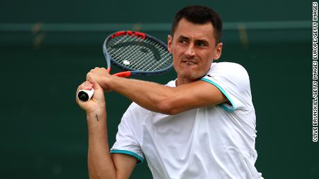 Tomic plays a backhand in his first round match against Jo-Wilfred Tsonga.