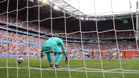 Megan Rapinoe scores her team's first goal from the penalty spot past Sari Van Veenendaal of the Netherlands.