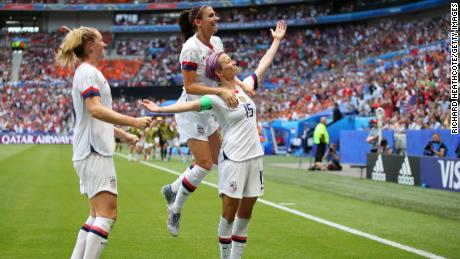 Megan Rapinoe of the US celebrates with teammates Alex Morgan and Samantha Mewis after scoring her team's first goal during the 2019 FIFA Women's World Cup France Final  yesterday at Stade de Lyon on July 7 in Lyon, France.
