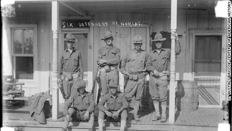 United States soldiers deployed to the US-Mexico border during The Massacre era pose for a photo.