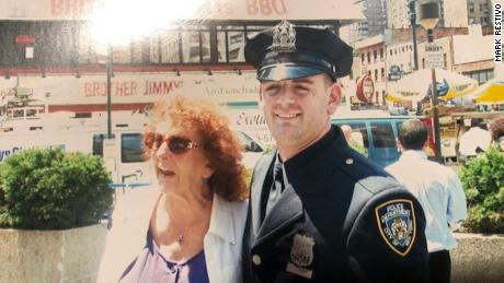 Mark Restivo with his grandmother at his graduation from the NYPD police academy in July 2008.