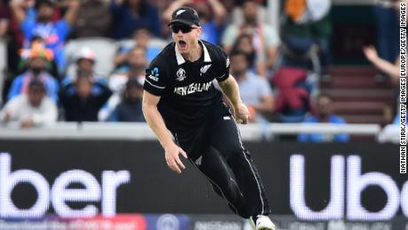 Jimmy Neesham catches Dinesh Kartik as New Zealand takes control at Old Trafford.