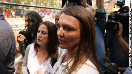 Courtney Wild, right, and another purported victim of Jeffrey Epstein  leave a Manhattan court house after a hearing on sex trafficking charges against Epstein on July 8, 2019 in New York City.