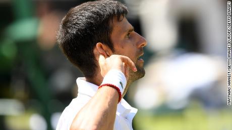 Novak Djokovic reacts after winning a titanic 45-shot rally.