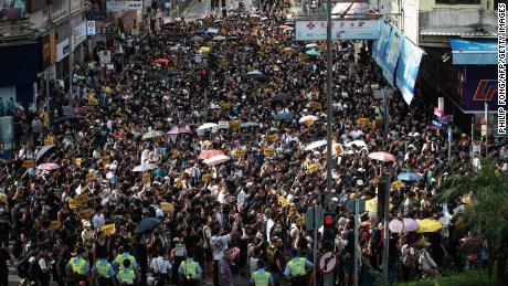"Hong Kong police called for demonstrators to ""leave peacefully"" after scuffles developed between protesters and police."