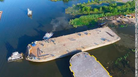 A sunken barge in Bayou Chene, meant to reduce flood risk, measures 400 feet long, 100 feet wide and 20 feet tall.