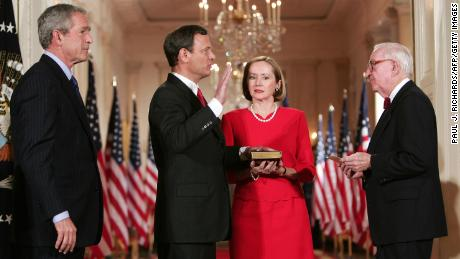 Judge John Roberts is sworn in as US Supreme Court Chief Justice in September 2005 at the White House by US Supreme Court Justice John Paul Stevens.
