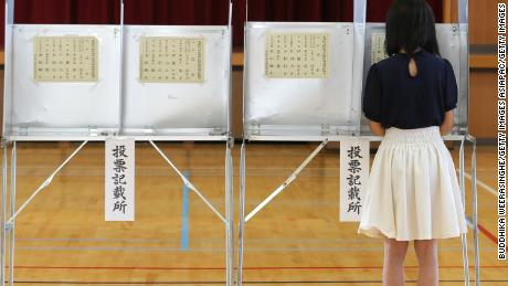 An 18-year-old woman casts her vote for parliament's upper house election at a polling station on July 10, 2016 in Himeji, Japan.