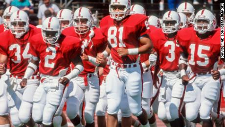 PALO ALTO, CA -  1989:  Cory Booker #81 and his Stanford Cardinal teammates jog on the field during warmups prior to a football game during the 1989 season at Stanford Stadium in Palo Alto, California.  Other visible players include Scott Eschelman #34, Alan Grant #2, Kevin T. Scott #3,  and Gary Taylor #15