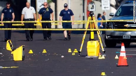 Evidence markers rest on the street at the scene of a mass shooting in Dayton, Ohio.