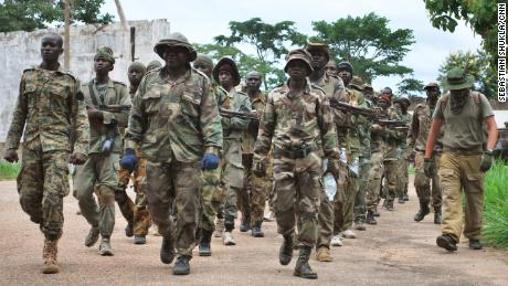 Central African Army (FACA) troops march alongside their Russian trainers at Berengo, once the palace of former CAR President Jean-Bédel Bokassa. More recently these recruits have been fighting to repel rebel attacks across the country.