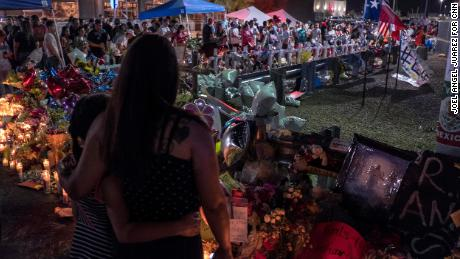Amber Basurto, 9, left, and her mother, Priscilla Basurto, 39, visit a memorial for the El Paso victims on Thursday.