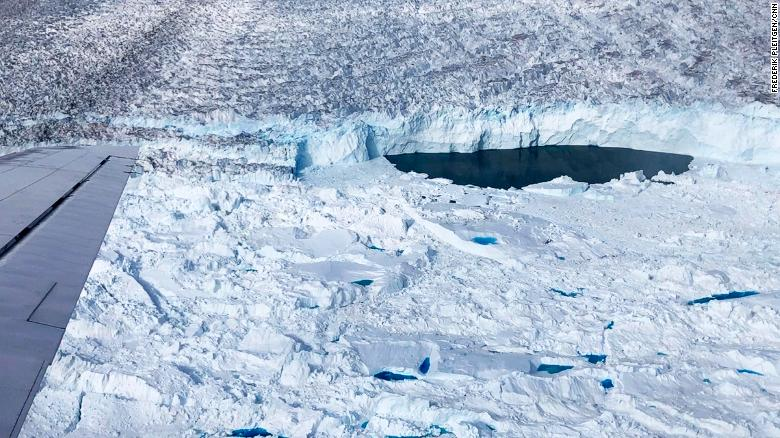 """Ice-free """"lake"""" at the front of Helheim glacier seen from a DC-3 plane."""