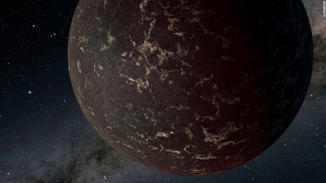 This artist's illustration shows LHS 3844b, a rocky nearby exoplanet. It's 1.3 times the mass of Earth and orbits a cool M-dwarf star. The planet's surface is probably dark and covered in cooled volcanic material, and there is no detectable atmosphere.