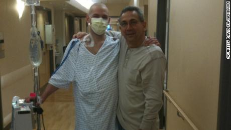 David Fajgenbaum poses with his father during one of his hospital stays.