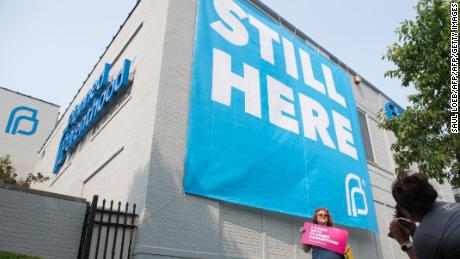 In today's political storm, Planned Parenthood needs two umbrellas