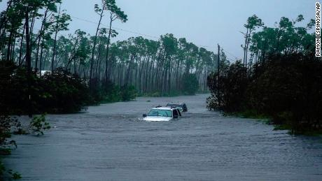 Cars sit submerged in water from Hurricane Dorian in Freeport, Bahamas, Tuesday.