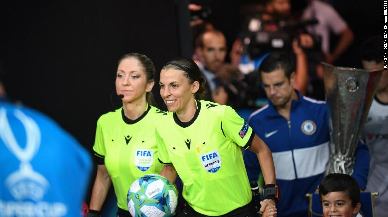 Stephanie Frappart and Manuela Nicolosi walk out for the UEFA Super Cup final.