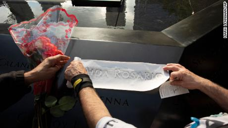 Louis Gonzalez makes a rubbing of his sister's name at the National September 11 Memorial on Wednesday.