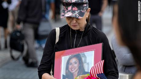 Connie Dray of West Virginia holds a photo her cousin Mary Lou Hague, who died at the World Trade Center.