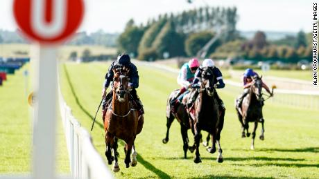 Ryan Moore riding Flag Of Honour (left) to win the Irish St. Leger at the Curragh in 2018.