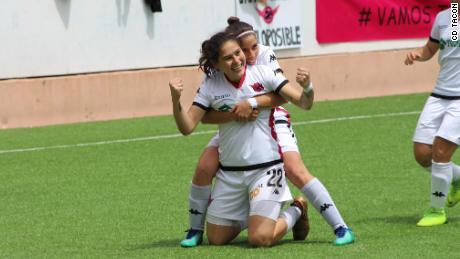 Two CD Tacon players celebrate after scoring a goal.