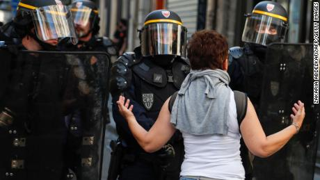 A woman speaks to riot policemen during an anti-government demonstration in Paris in September 2019.