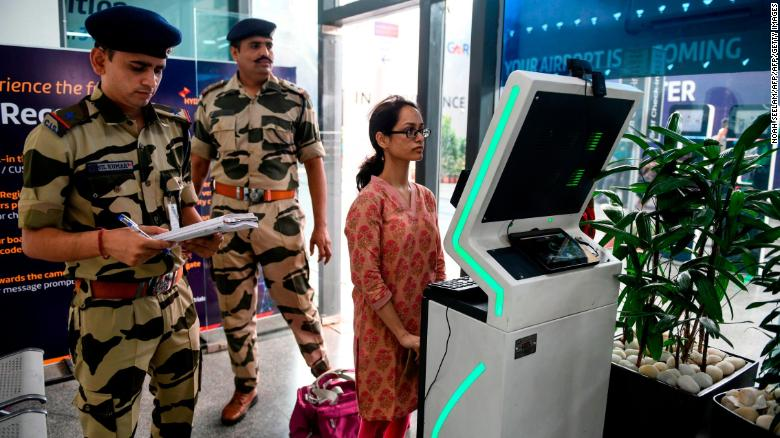 A passenger stands as she registers her personal details at a facial recognition counter at the Rajiv Gandhi International Airport in Hyderabad, on July 26, 2019.