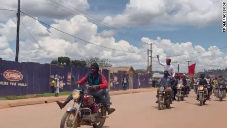 Popstar Bobi Wine escapes house arrest in daring motorbike stunt